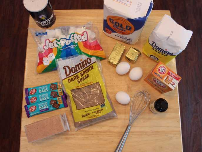 s'mores stuffed cookie ingredients include cookie ingredients, marshmallows, graham crackers, and chocolate bars